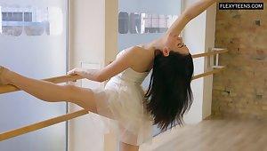 Lovely sexy dancer Saule Elastiga is impatient to flash her natural titties