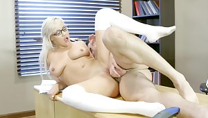Blonde whiz is screwed above the table by her math teacher